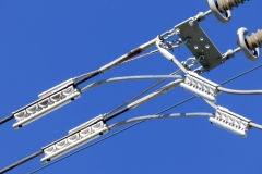 CSS-1302-060 ClampStar unit with corona shields and Safe-T-Link tether installed on 220 kv, 1033.5 kcmil ACSR line